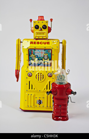 Two toy robots - Stock Photo