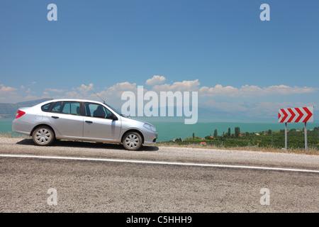 Turkey, Western Anatolia, lake at Egirdir, car, renault clio turkish model - Stock Photo
