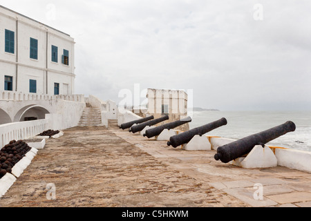 A row of cannons at Cape Coast Castle, a former slave fort. Cape Coast, Ghana - Stock Photo