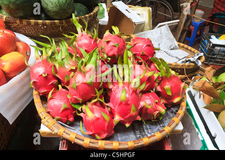 Dragon fruit for sale in Hom Market, historic Old Quarter of Hanoi, Veitnam - Stock Photo