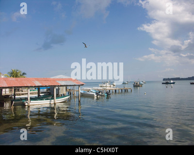 Fishing boats in the harbour on the Carribean coast of Livingston, Guatemala - Stock Photo