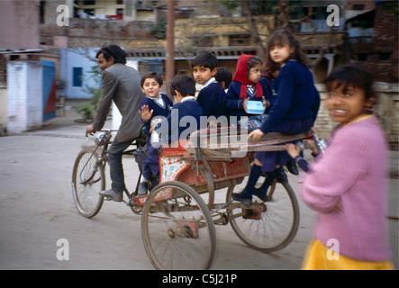 Amritsar India Children Going To School On bicycle Rickshaw - Stock Photo
