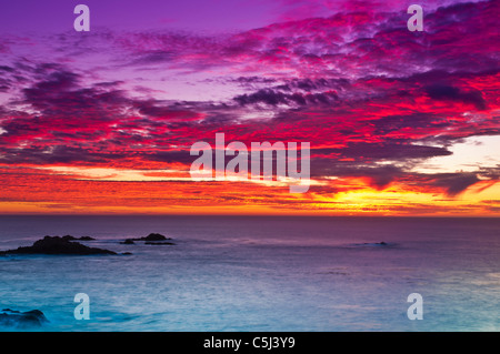 Sunset over the Pacific Ocean, Point Lobos State Reserve, Carmel, California - Stock Photo