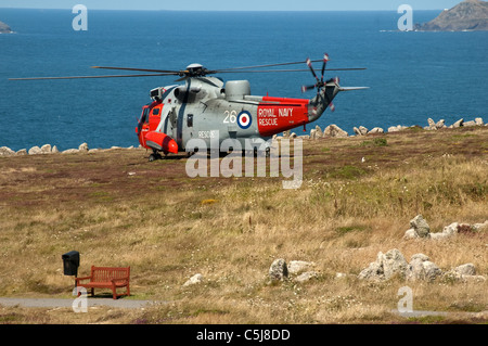 SEa King Royal Navy Helicopter landing during rescue exercise. - Stock Photo
