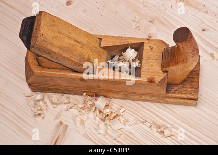 tooth plane tool hand wood shavings workmanship - Stock Photo