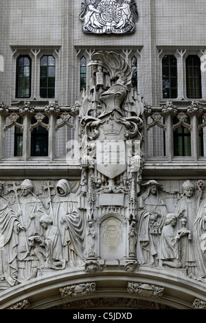 Stone carving over entrance of Privy Council Supreme Court building, Parliament Square, London, England - Stock Photo
