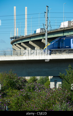 A train on the high speed rail link passes by the Dartford River Crossing in Thurrock,Essex, UK. - Stock Photo