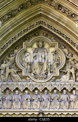 Detail of stone carvings of Jesus, angels and disciples on tympanum of Great North Door, Westminster Abbey, London, - Stock Photo