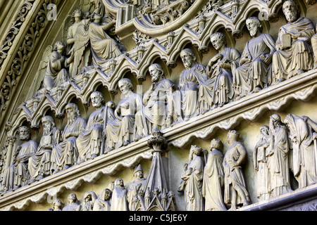Detail of stone carvings of 12 twelve disciples on tympanum of Great North Door, Westminster Abbey, London, England - Stock Photo