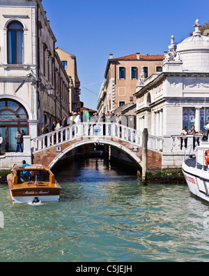 VENICE ITALY-APR 06 2011: Walking bridge over canal in Venice with people - Stock Photo