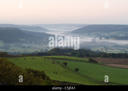 Autumn morning with cloud inversion overlooking the Chatsworth Valley in the Peak District National Park - Stock Photo
