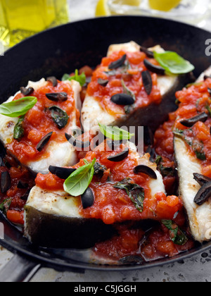 Halibut frying in a pan - Stock Photo