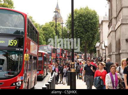 Buses and people on Whitehall, Westminster, London, England, U.K. - Stock Photo