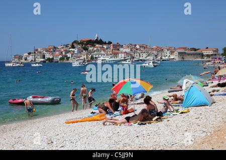 Pebble beach at the Croatian town Primosten - Stock Photo