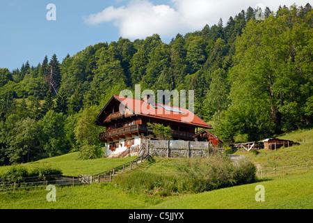 Alpine house with solar heating panels in the roof in the mountains near Partnachklamm in Garmisch-Partenkirchen, - Stock Photo
