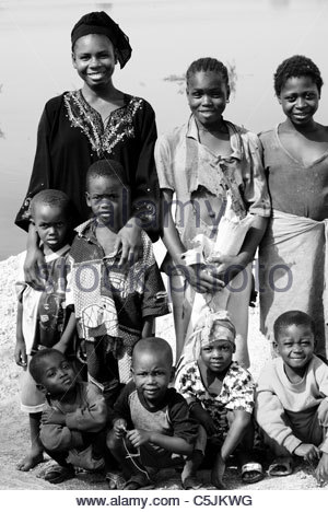 Young African woman family portrait next to the Niger River in Bamako Mali Africa - Stock Photo