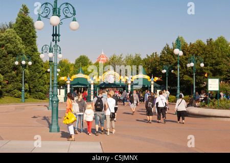 People on their way to the park at Disneyland Paris in France - Stock Photo