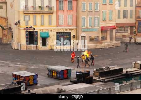 A stuntman on fire showing movement at the Moteurs...Action stunt show spectacular at Disneyland Paris in France - Stock Photo