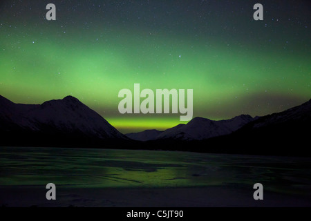 Northern Lights over Upper Trail Lake, Alaska. - Stock Photo