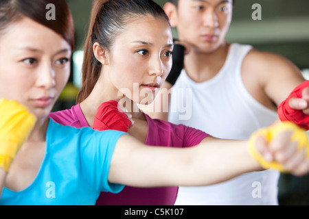 Young Woman in Boxing Class - Stock Photo