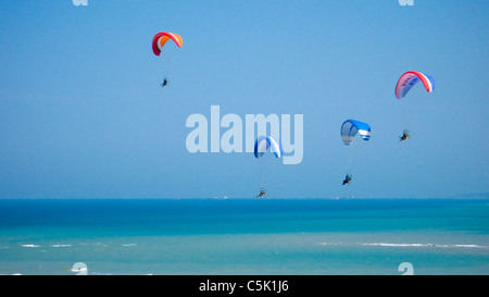 Four powered paragliders flying above the Black Sea in Istanbul, aerial, view, Turkey - Stock Photo
