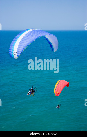 Two powered paragliders flying above the Black Sea coast of Istanbul, aerial, view, Turkey - Stock Photo