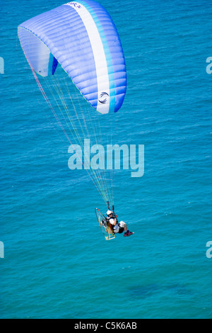 Powered paraglider flying above the Black Sea coast of Istanbul, aerial, view, Turkey - Stock Photo
