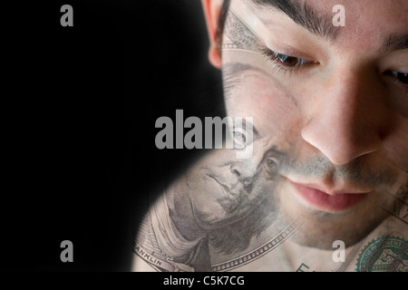 This young man is experiencing intense anxiety over having a hard time paying the bills or other financial hardship. - Stock Photo