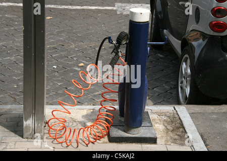 car tyre air inflater at garage in city town - Stock Photo