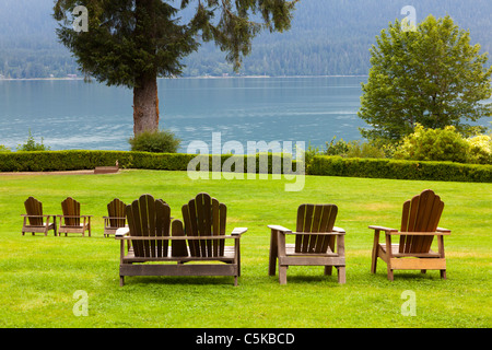 Easy chairs looking out over Lake Quinault  at Lake Quinault Lodge Olympic National Park Washington USA - Stock Photo