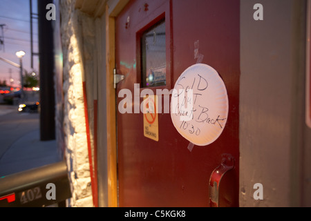 handwritten sold out sign on a paper plate stuck to the door of the station inn nashville tennessee - Stock Photo