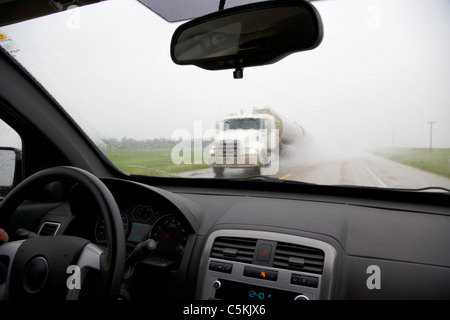 a car travelling through heavy rain water spray on a public road re stock photo royalty free. Black Bedroom Furniture Sets. Home Design Ideas