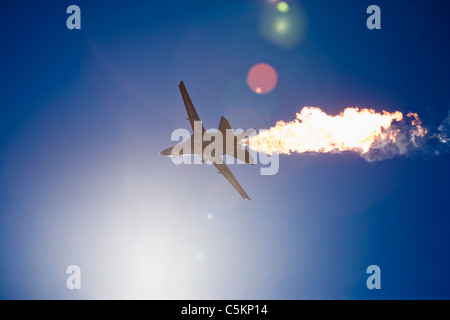 General Dynamics F-111 jet fighter aircraft of Royal Australian Air Force seen from below against the sun, with - Stock Photo
