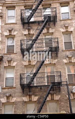 Zig zagging fire escape on the exterior of old apartment building in New York City. - Stock Photo