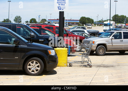cars trucks suvs parked in car parking lot of supermarket in the usa - Stock Photo