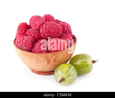 Wooden bowl full of fresh raspbarry with two gooseberry isolated on white background - Stock Photo