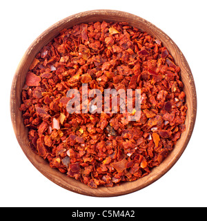 Wooden bowl full of red chili pepper isolated on white background - Stock Photo