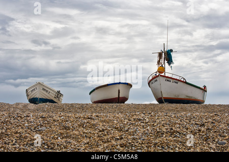 Fishing boats on shingle beach, Blakeney Point, Norfolk - Stock Photo