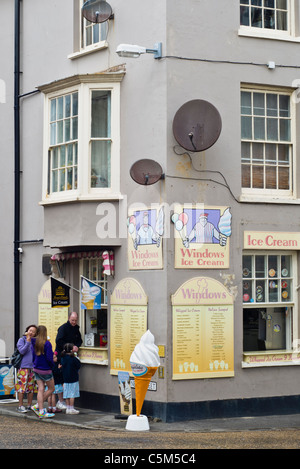 A family buying ice creams from a parlour, Cromer, Norfolk - Stock Photo