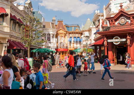 People in the Main Street USA at Disneyland Paris in France - Stock Photo