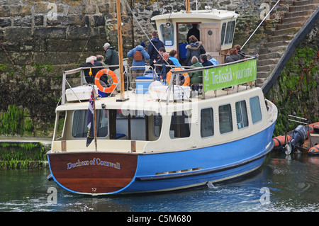 Passengers about to leave the traditionally built ferry, 'The Duchess Of Cornwall' at St. Mawes - Stock Photo