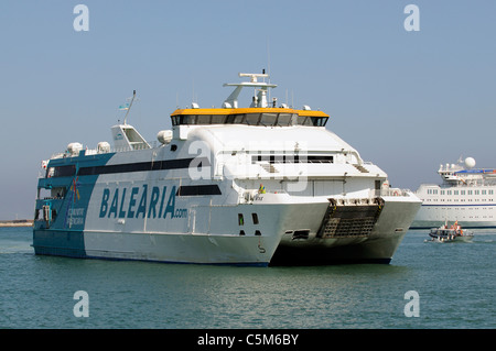Fast Ferry the Nixe arriving Eivissa Port on the Spanish Island of Ibiza arriving from Formentera - Stock Photo