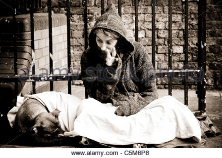 Homeless man with his dog sitting on the floor who became angry and aggressive during the portrait session - London - Stock Photo