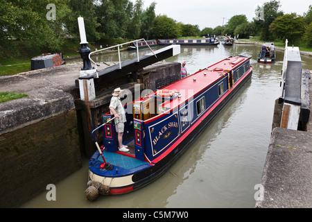 Narrowboat going through Calcutt Locks on the Grand Union Canal, Warwickshire - Stock Photo
