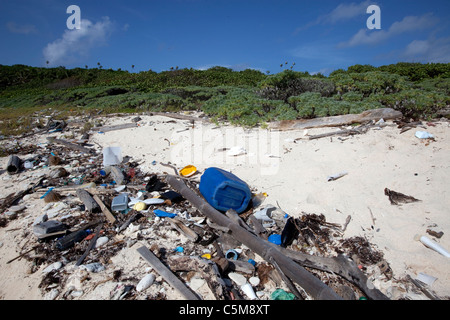 Marine debris including trash and plastics washed up along the shore of Swan Island, located 90 miles off the coast - Stock Photo