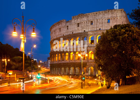 Car light-trails in front of the Roman Coliseum at dusk, Rome Lazio Italy - Stock Photo