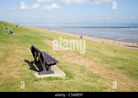 Bench seats look out over the sea at Minster on the Isle of Sheppey, Kent, England.