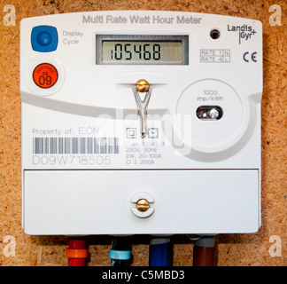 Multi Rate Watt Hour Electricity meter installed in a domestic house in the UK used to provide energy consumption - Stock Photo