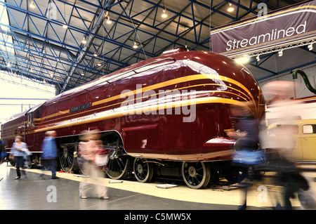 Steam locomotive No 6229 Duchess of Hamilton at  the National Railway Museum in York with visitors blurred as they - Stock Photo