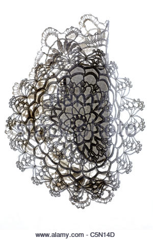 decorative doilies made from lace partly folded - Stock Photo